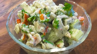 This easy Imitation Crab Salad recipe is a tasty seafood salad that is low in calories and packs a nice crunch. | Tiny Kitchen Cuisine | https://tiny.kitchen