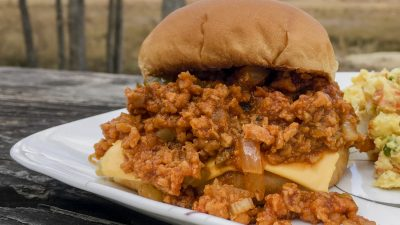 My recipe for vegetarian sloppy joes uses TVP (textured vegetable protein) mixed with a thick and tangy tomato sauce to make this spin on a classic sandwich. Delicious and healthy! It's so flavorful that even avid meat-eaters won't notice there's no meat! | Tiny Kitchen Cuisine | https://tiny.kitchen/